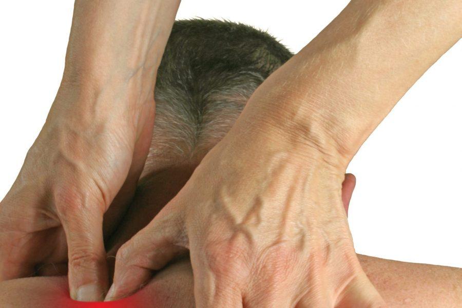applying pressure to trigger point on shoulder